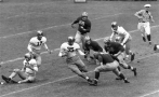 "FILE - In this Oct. 13, 1945, file photo, Army halfback Felix Blanchard (35) weaves away as three Michigan men close in to tackle him after a 3-yard first-period gain in a college football game in New York. Michigan players are Stuart Wilkins (68), Dominic Tomasi (65), Harold Watts (58), and Walter Teninga (42). Army's Albert Nemetz (75) is in the background. Felix ""Doc"" Blanchard, the 1945 Heisman Trophy winner and Army's Mr. Inside in one of college football's most famous backfields, has died. He was 84. (AP Photo/File)"