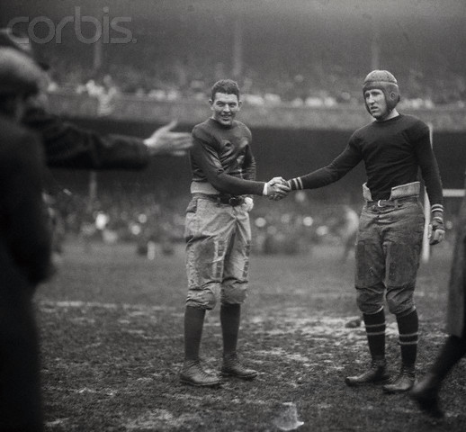 Football Players Behaving Amicably on Field