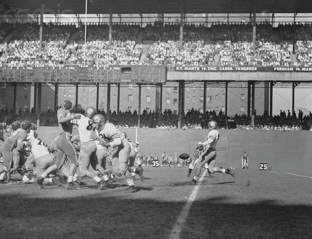 17 Oct 1953, Manhattan, New York, New York, USA --- Army football team player, Chesnauskas (63), quick kicks the ball in first quarter of Army v. Duke University game at Manhattan's Polo Grounds. --- Image by © Bettmann/CORBIS