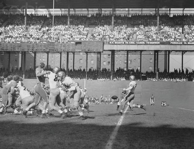 17 Oct 1953, Manhattan, New York, New York, USA --- Army football team player, Chesnauskas (63), quick kicks the ball in first quarter of Army v. Duke University game at Manhattan's Polo Grounds. --- Image by © Bettmann/CORBIS