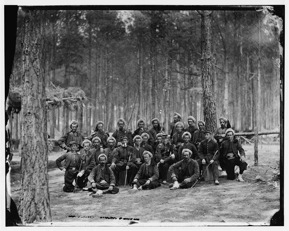 Company G, 114th Pennsylvania Infantry (Zouaves) taken around Petersburg in August, 1864..jpg